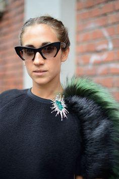 Delfina Delettrez tops her Fendi essentials with quirky Miu Miu shades.