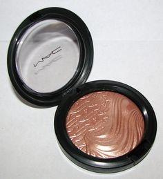 MAC Superb Extra Dimension Highlighter... if you can find it... buy it.  Click through for FOTD and swatches!