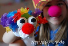 Make a circus clown puppet from a sock and ping pong balls!