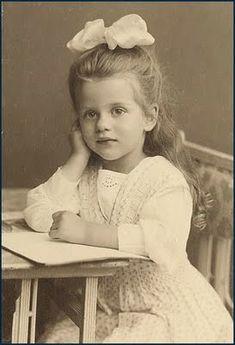 Sweet Victorian girl at desk, vintage photo