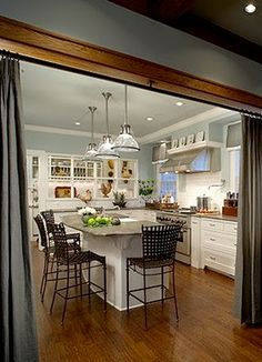 Love this kitchen and the curtain divider is so cute