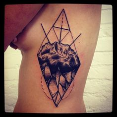 geometric stone tattoo --might be cool to have mountains in there instead of just a stone