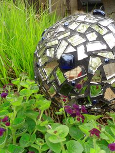 Garden Accent ~ A bowling ball makes a great base for a garden mosaic gazing ball. Broken mirror pieces and blue marbles glued-on and grouted do the trick. Leave a hole open to prop the ball on a dowell or stake in the garden.