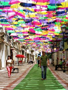 Hundreds of Umbrellas Once Again Float Above The Streets in Portugal - via Bored Panda 11.07.2014 | Every July, as part of AgitÁgueda art festival, hundreds of umbrellas are hung over promenades in the streets of Águeda, a municipality in Portugal. The beautiful tradition started only 3 years ago, but has already earned world fame for the place.
