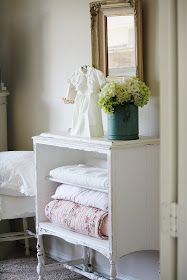 DIY:   An old cabinet is painted, distressed &  repurposed (no drawers or doors) into a place to store quilts.  Brilliant!