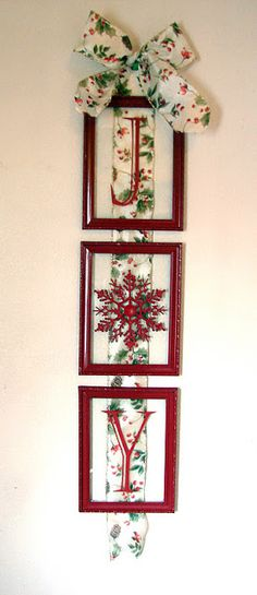 diy Joy wall decor~ three dollar store frames spray painted red, dollar store snowflake ornament spray painted red, J and Y vinyl letters and ribbon