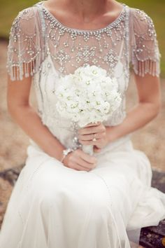 Pretty vintage style silver beaded cape over wedding dress
