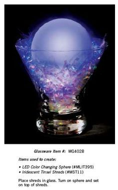 Create this unique look by adding tinsel to a glass and a color changing sphere. Turn on the light and set it in the glass.
