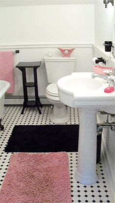 Pink and black and white bathroom