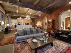 Exposed brick and exposed beams with the modern fixtures.  Wonderful.