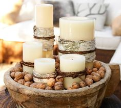 A modern décor often doesn't call for traditional decorations, this Christmas centerpiece offers a charming solution with its natural elements of rustic wood bowl, candles and nuts.