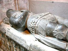 Sarcophagus-effigy at Dunkeld Cathedral of Alexander Stewart, Earl of Buchan, Alasdair Mór mac an Rígh, and called the Wolf of Badenoch (1343 – 20 June 1405). He was the third surviving son of King Robert II of Scotland and youngest by his first wife, Elizabeth Mure of Rowallan. Alexander married the widowed Euphemia I, Countess of Ross, but they had no children although he did have a large family by his longtime mistress, Mairead inghean Eachann.