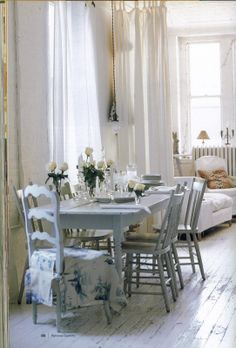 Cottage ● Dining Room with White Wood Floors
