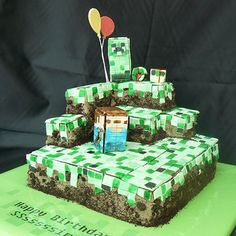 Minecraft Cake  by Party Ideas UK http://www.partyideasuk.co.uk/library/cakes/birthday/minecraft-cake-2.aspx