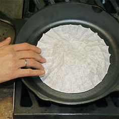 Prevent Rust    Place a coffee filter inside a cast-iron skillet to absorb excess moisture when it's not in use.