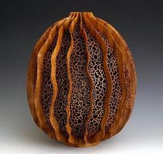 Wood carved seed by j. paul fennell