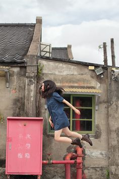 """Japanese photographer Natsumi Hayashi glides through Tokyo without ever really touching her feet to the ground in her levitation photographs. Getting the right shot involves many attempts, and Hayashi says she either works with a friend or by herself through this following process: """"First, I get a composition and a focus manually. Then I press the shutter release, run to the right position for a levitation...and jump by my intuition.  Incredible timing and composition of scenes. How creative!"""