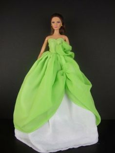 A Stunning Two Tone Gown in Lime Green and White Made to Fit the Barbie Doll by Olivia's Doll Closet. $7.00. Size: Great for 30 cm Barbie dolls & other 30 cm dolls;. A great gift for your children ,your friends and yourself .. A Stunning Two Tone Gown in Lime Green and White Made to Fit the Barbie Doll. Please note:   that all items are made for and or by Olivias Doll Closet,  they are made to fit the popular Barbie Doll  products.   We are not affiliated with Mattel...