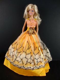 Golden Yellow Ball Gown with White and Black Lace and Brown Flower Made for the Barbie Doll by Olivia's Doll Closet. $5.50. Golden Yellow Ball Gown with White and Black Lace and Brown Flower Made for the Barbie Doll. 100% Brand new  Size: Great for 30 cm Barbie dolls & other 30 cm dolls. Package includes: 1X Clothes (Doll not included, only the Clothes). Handcrafted Especially for Olivia's Doll Closet to fit the Barbie Doll. A great gift for your children ,you...