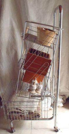 Vintage Industrial Wire 4 Basket Rolling Storage Cart. $325.00, via Etsy.