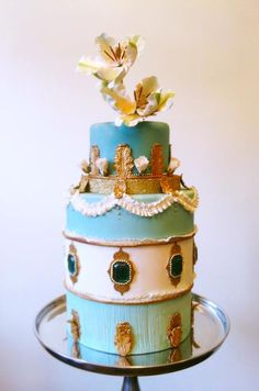 Beautiful blue and gold cake By Connie Cupcake