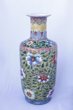 Fine Chinese ovoid porcelain vase, with a spreading lip, above cylindrical neck, enameled with trailing flower heads in bright tones of orange, blue, pink and green on a yellow ground, evidence of minute crazing to surface, on circular foot, with six character Kangxi in double circle to base, h 25.5cm