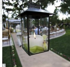 lanterns everywhere :) ceremoni idea, hooks, green, candles, shepherd hook, deck, flowers, lanterns, black glass