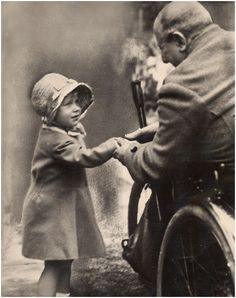 Princess Elizabeth of York shakes hands with an old soldier. ca 1929. London.