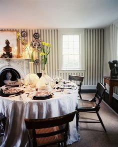 striped walls and antique chairs ~ home of John Dransfield and Geoffrey Ross
