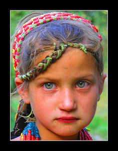 """""""Kalash Girl - Northern Pakistan. The Kalash are fascinating. They don't share DNA markers with any other races/peoples, and they are so isolated they have managed to preserve their culture. They're the only non-muslim people in Pakistan. Even more interesting, most don't look caucasian like this girl, but it happens in their gene pool, a lot."""""""