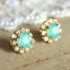 Turquoise and diamond studs.