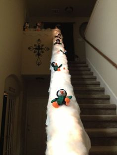 Turn your banister into a penguin slide!  Oh my gosh.... Freakin precious!!