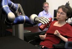 People with paralysis control robotic arms using brain-computer interface