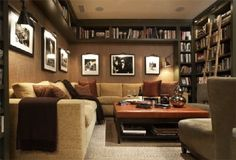 Finished basement - Love the bookshelves above the couch to create cozy space. Without shelves it would be so boring.