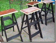 Step ladders turned into bar stools.  Very nifty.