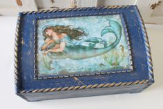 Go under the sea with this elegant, yet fun wood treasure chest, suitable for anyone at any age, for jewelry and treasures alike.   Under the Sea Mermaid Treasure Box - Nautical Jewelry Box - California Seashell Company