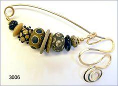 fibula pin by Robin Atkins, bead artist.