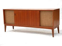 Clairtone Stereo Cabinet. It's almost exactly like the one that my parents bought shortly after their marriage, in 1961. They traded in my mother's old upright piano for it, a decision she would always regret. But I loved the thing, and as soon as I was old enough to use it, I played the hell out of it until my parents wisely decided that in order to save their sanity, I needed to have a record player of my very own. :)