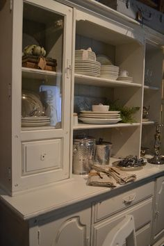 Love the ironstone and silver on this creamy hutch at www.chartreuseandco.com/tagsale