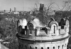 The Joslyn Castle tower is in the foreground with the Omaha skyline behind in March 1971. THE WORLD-HERALD