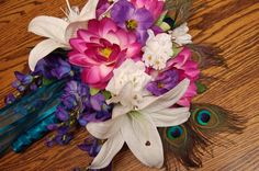Peacock feathers in a handheld bouquet