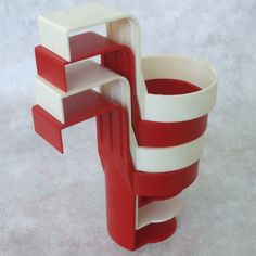 Ah - the ORIGINAL car cup holders that hung from the window...IF you were even allowed to drink in the car.
