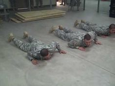 "These army men show how to do a workout to ""The Cupid Shuffle.""  This is happening in a rec room near you soon!"