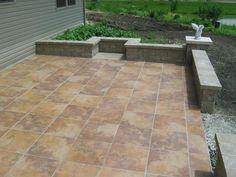 tile patio, brick wall