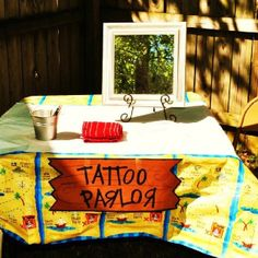 Pirate Party Idea...Tattoo parlor with temporary tats, black eyeliner for scars/beards/mustaches, and a mirror to check out their new pirate look!