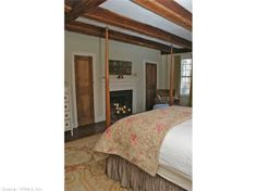 Large 21' x 14' Master bedroom with fireplace and plenty of closet space. Find this home on Realtor.com