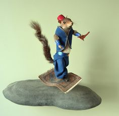 Rodent, on a flying rug, wearing a fez