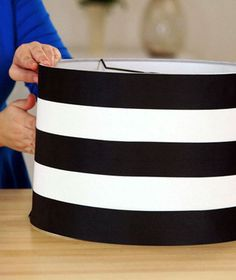 Watch this quick video to learn how to decorate a plain lampshade to graphic stripes with ribbon.