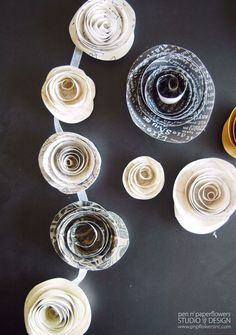 DIY paper flowers. Would be fun to do with junk mail or old book pages.