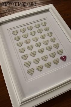 Cute heart cut outs as framed art.  I like that she found particular words to punch out.